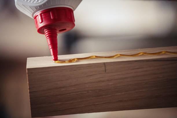 Close up of glue on wood stock photo