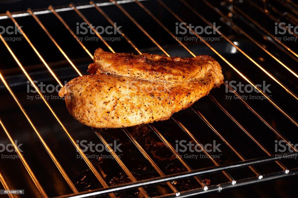 Close up of golden chicken breast on grill Lizenzfreies stock-foto