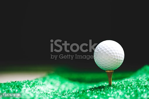 Close up of Golf ball on tee ready to be shot