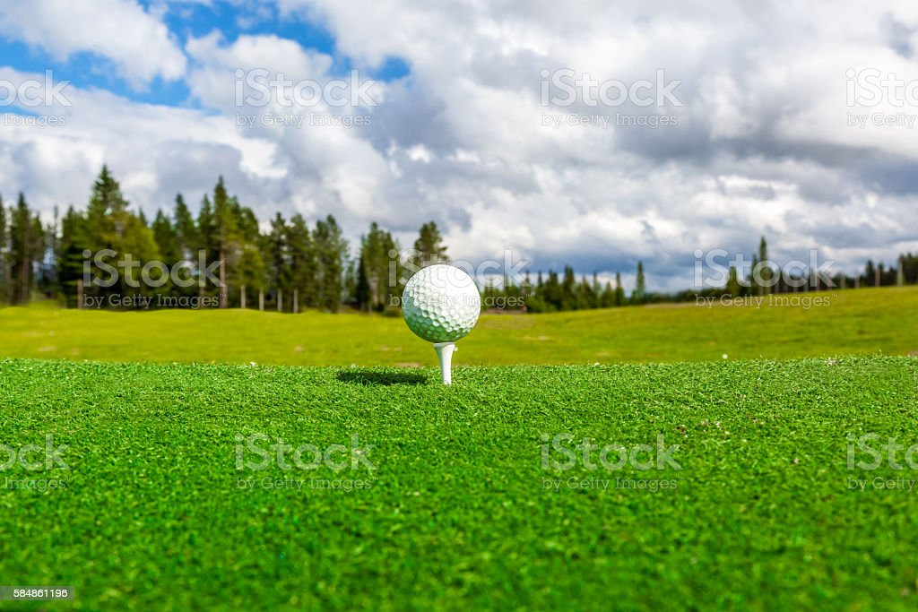 Close up of golf ball, perspective of summer landscape. stock photo