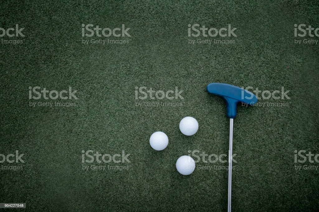 Close up of golf club and golf balls