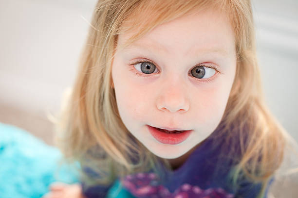 Close Up of  Goofy Little Girl Crossing Her Eyes stock photo