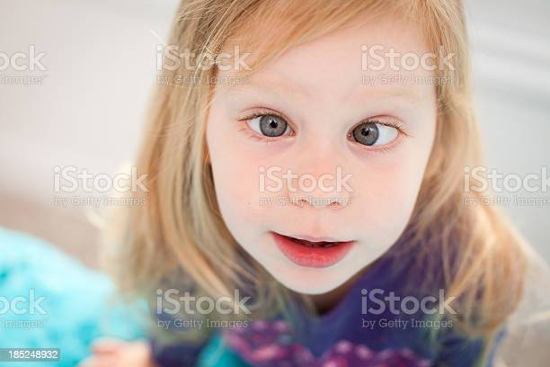 Close Up Of Goofy Little Girl Crossing Her Eyes Stock Photo - Download Image Now