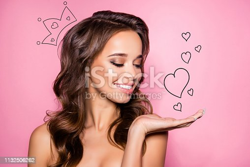 Close up of gorgeous charming brown wavy-haired lady ideal face presenting new product. Sales marketing discounts ad pampering lips dermatology healthcare concept isolated over pink pastel background.