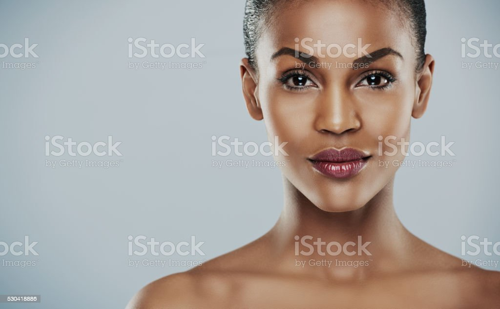 Close up of gorgeous woman over gray background stock photo