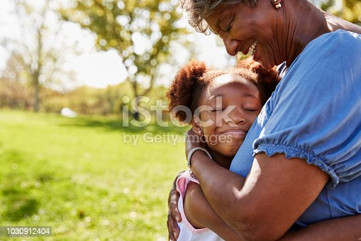 Close Up Of Granddaughter Hugging Grandmother In Park
