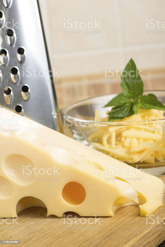 Close up of Grated cheese in Glass bowl royalty-free stock photo