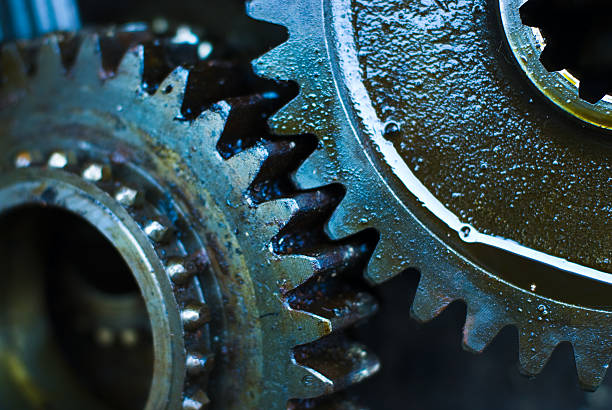 Close up of greasy and oily gears stock photo
