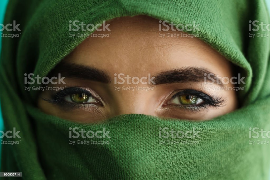 close up of green eyes of a girl stock photo