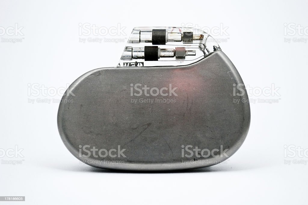 Close up of grey pacemaker against white background stock photo