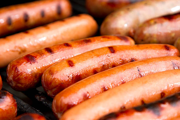 close up of grilled hotdogs on grill - hot dog stock pictures, royalty-free photos & images