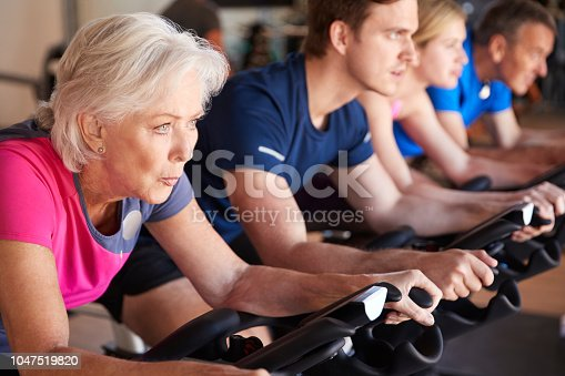 Close Up Of Group Taking exercise class In Gym