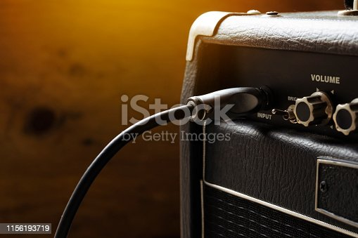 close up of guitar amplifier and  guitar jack, music concept
