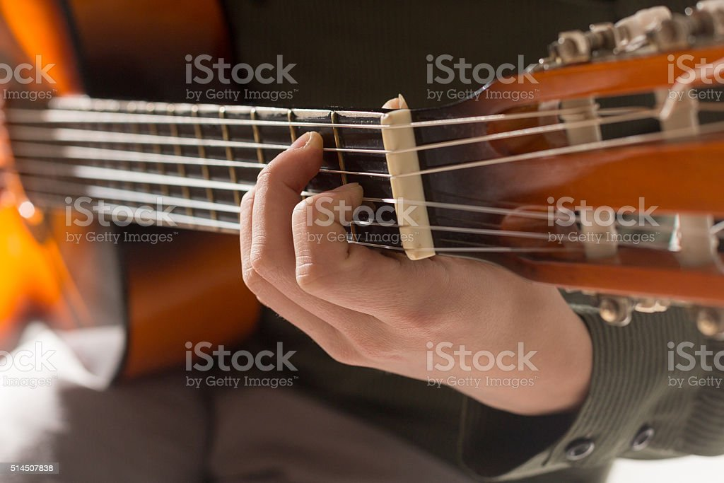 Close up of guitar player fingers stock photo