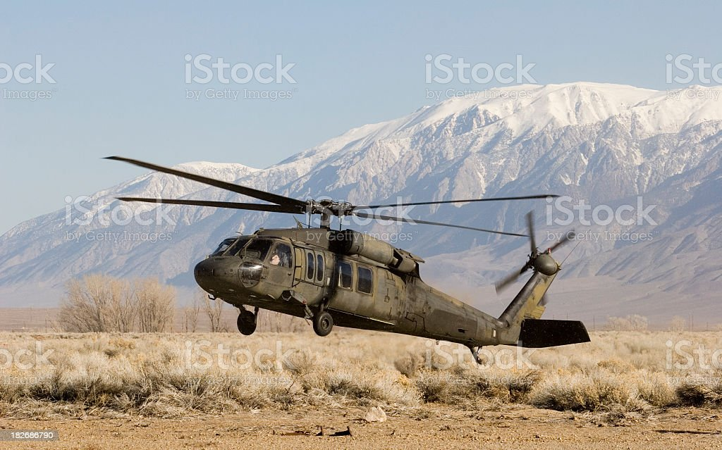 Close up of H-60 helicopter landing in the desert stock photo