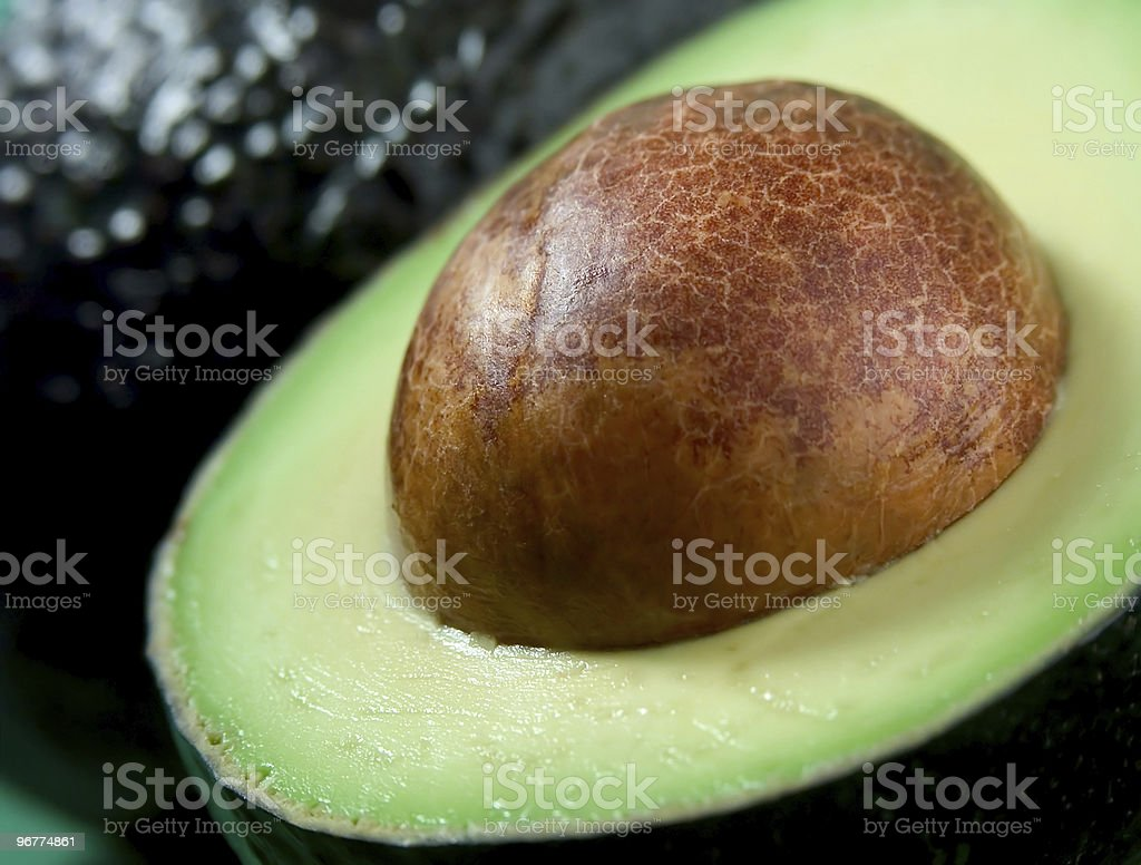 Close up of half an avocado with focus on seed royalty-free stock photo