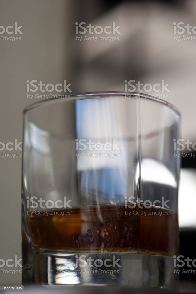 Close up of half filled alcohol glass royalty-free stock photo