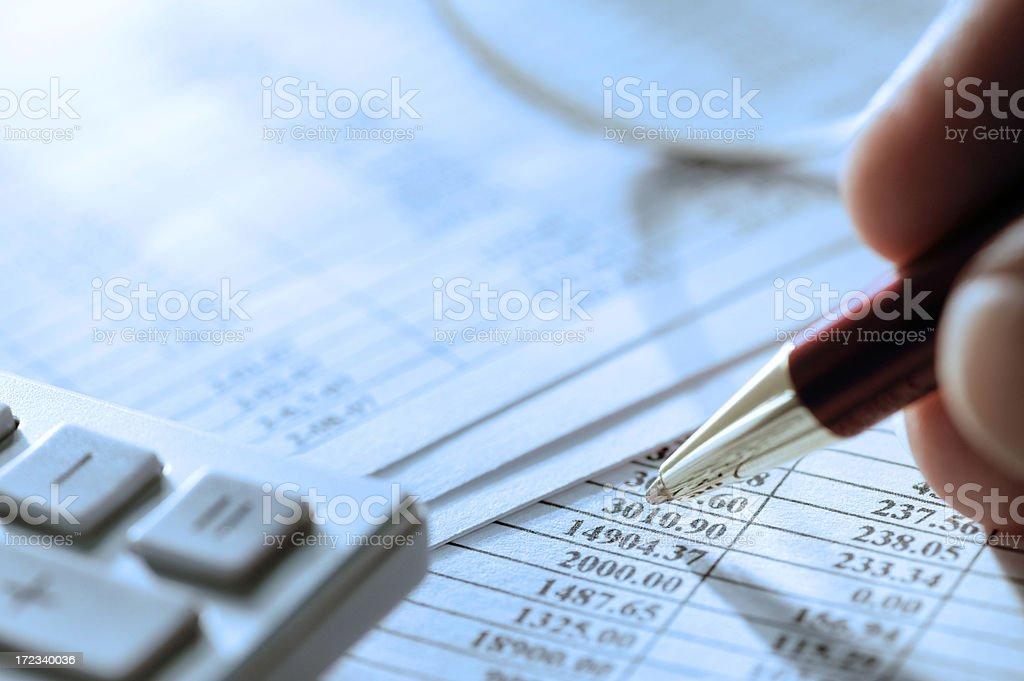 Close up of hand calculating financial figures royalty-free stock photo