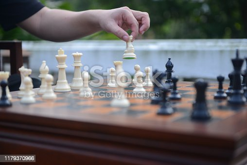 Close up of hand confident man playing chess game