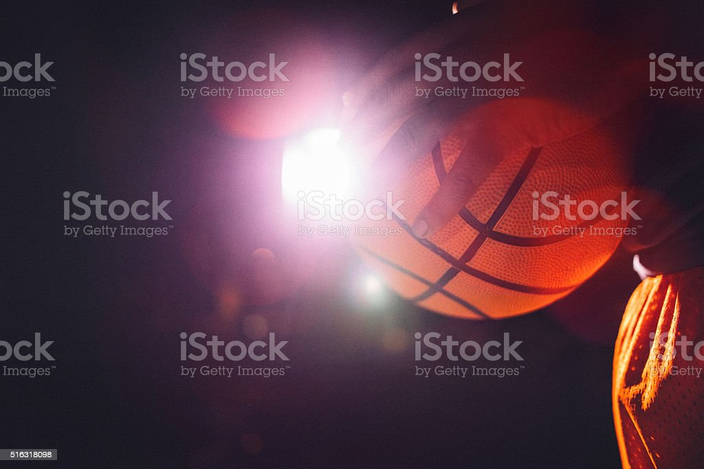 Close up of Hand Gripping Basketball stock photo