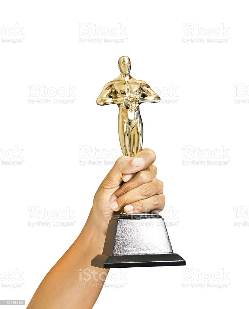 Close up of hand holding gold trophy royalty-free stock photo