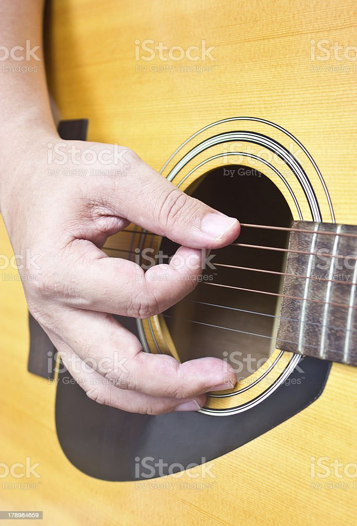 Close up of hand playing acoustic guitar. royalty-free stock photo