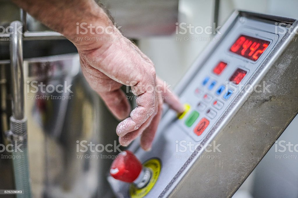 Close up of hand touching button stock photo