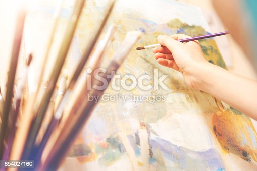 824254912 istock photo Close up of hand with brush working on abstract picture 854027160