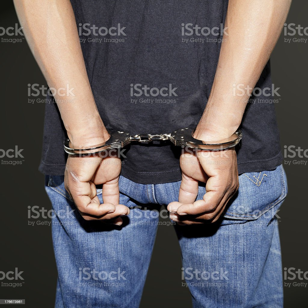 Close up of handcuffed hands royalty-free stock photo