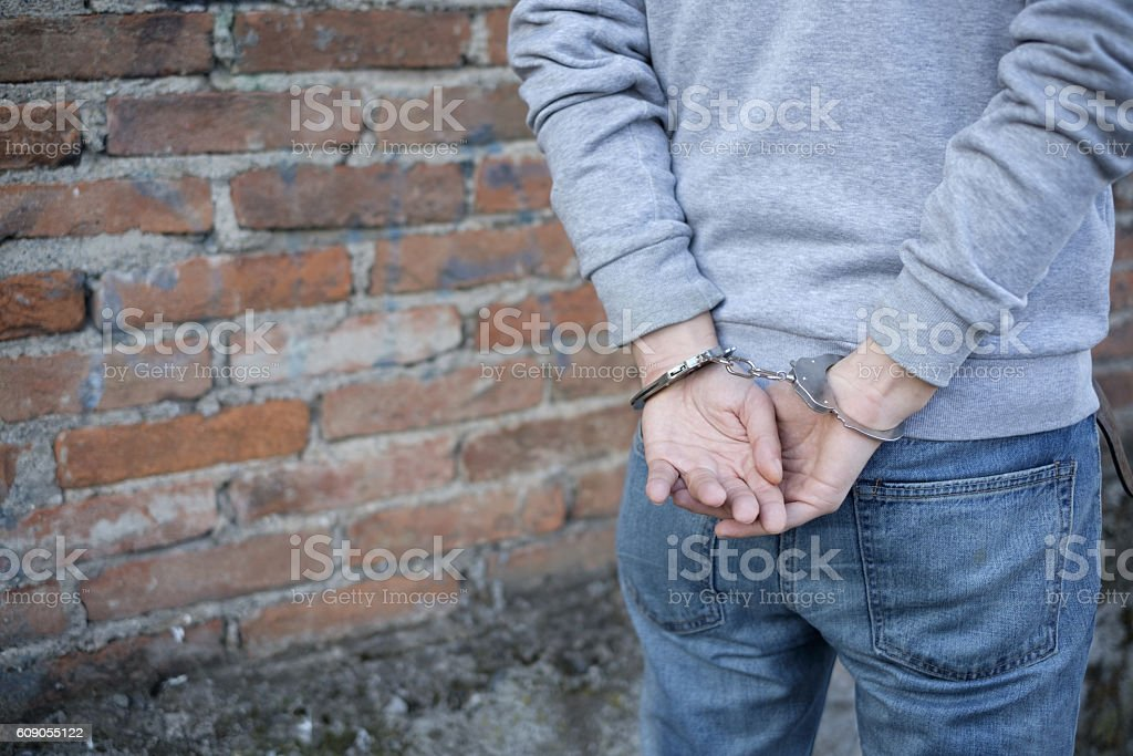 close up of handcuffed man hands – Foto