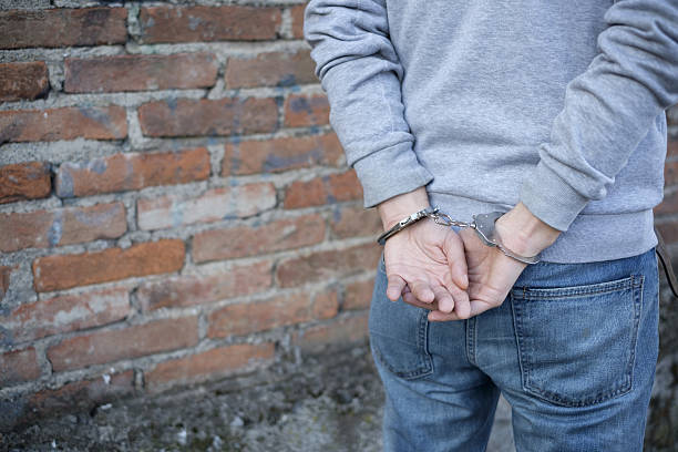 close up of handcuffed man hands - boy handcuffs stock pictures, royalty-free photos & images