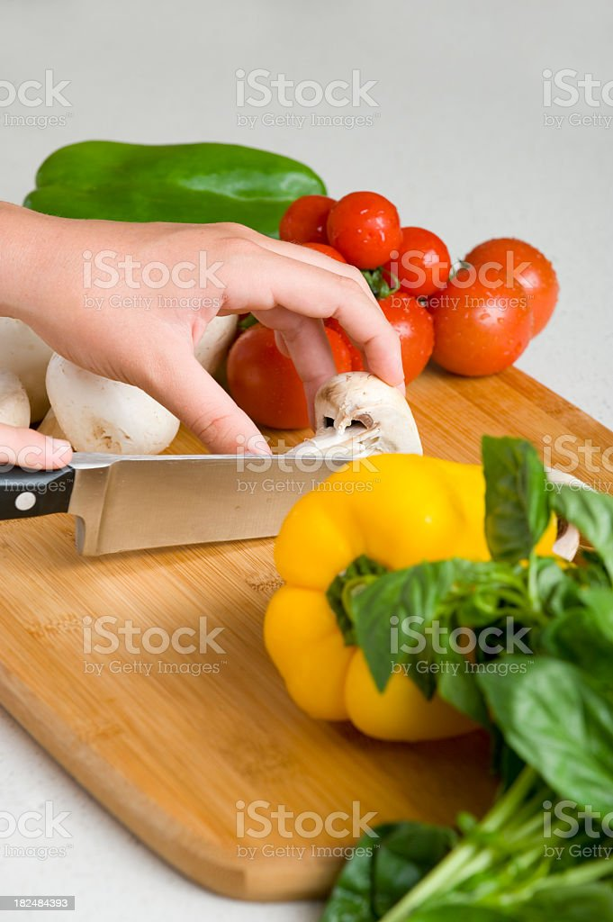 close up of hands chopping vegetables royalty-free stock photo
