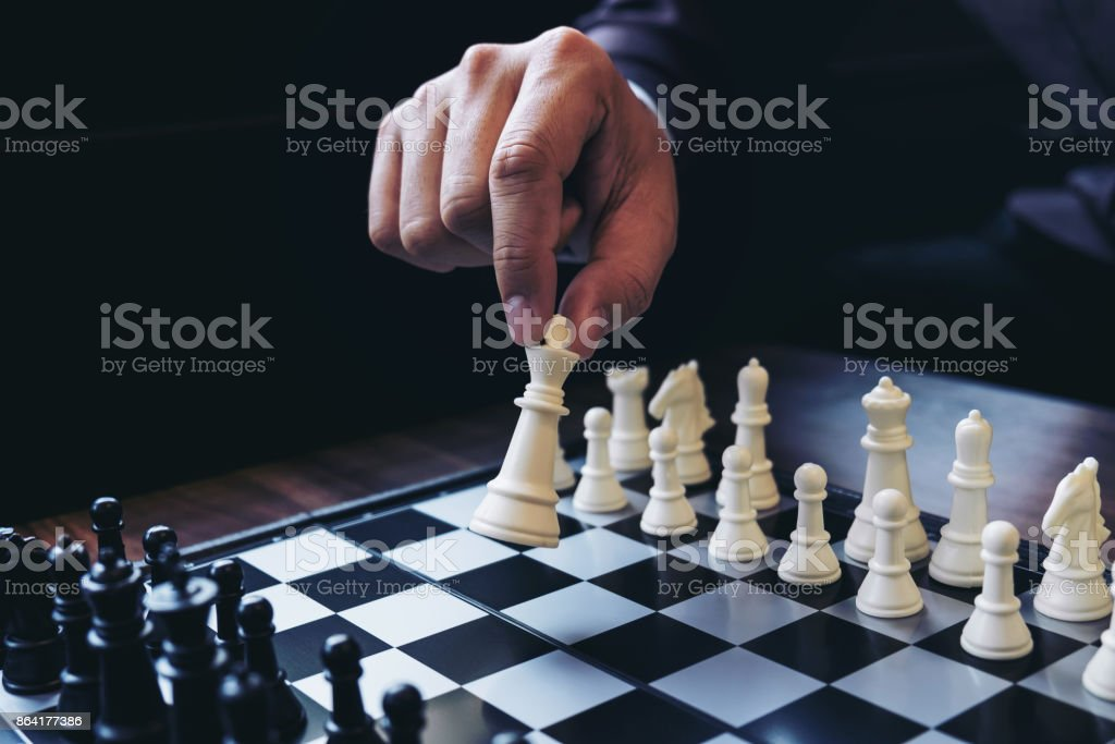 Close up of hands confident businessman colleagues playing chess game to development analysis new strategy plan, leader and teamwork concept for success. royalty-free stock photo