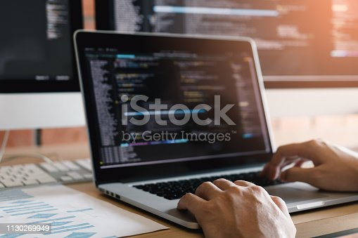 istock Close up of hands contemporary website developer man typing and writing code for program website and working on desk in office. 1130269949