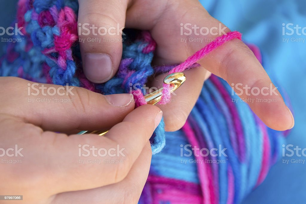Close up of hands crocheting a blanket stock photo