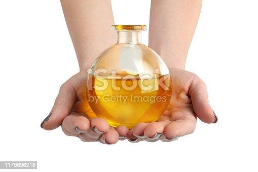 Close up of hands holding cruet of CBD oil