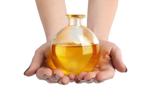 Close up of hands holding cruet of CBD oil Close up of hands holding cruet of CBD oil tincture stock pictures, royalty-free photos & images