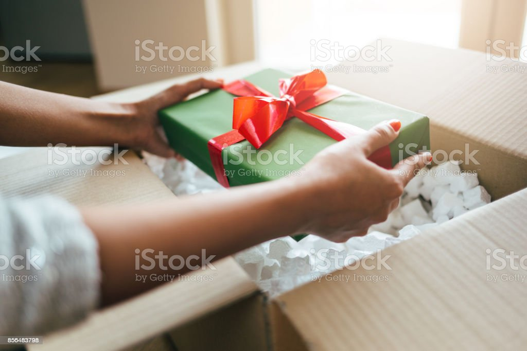 Close up of hands holding gift box stock photo