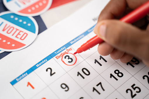 Close up of Hands marking November 3 election day on Calendar as reminder for voting - Concept of reminder for US election