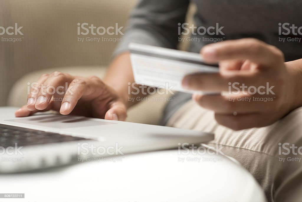 Close up of hands shopping online stock photo