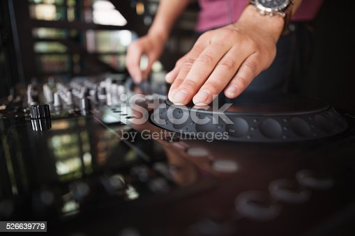 istock Close up of hands spinning the decks 526639779