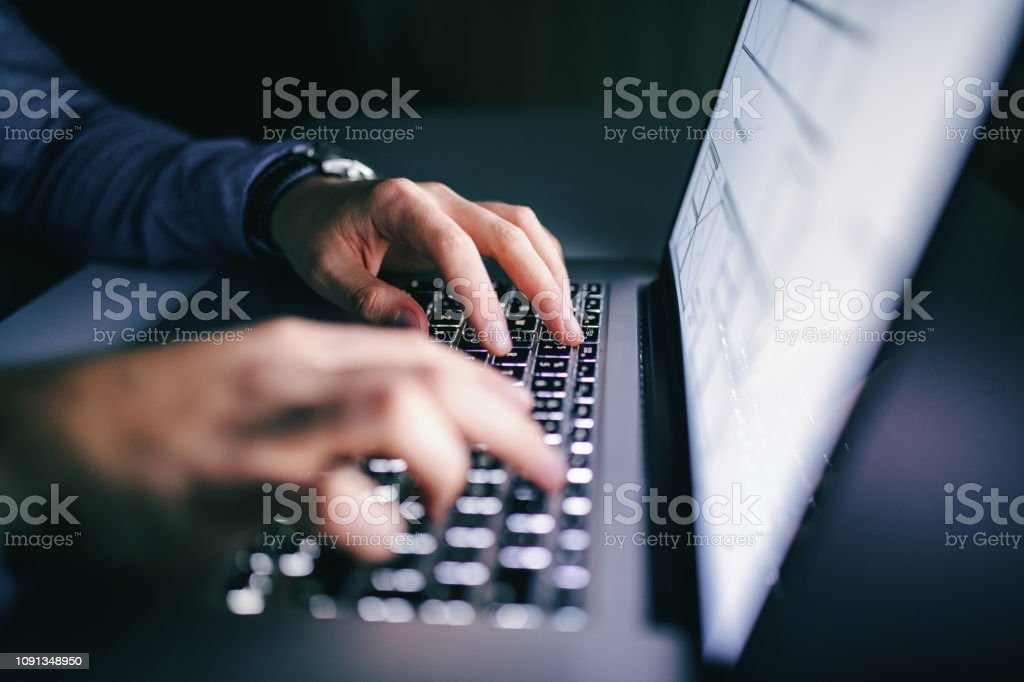 Close up of hands typing on laptop. Night work concept. royalty-free stock photo