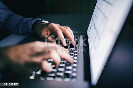 istock Close up of hands typing on laptop. Night work concept. 1091348950