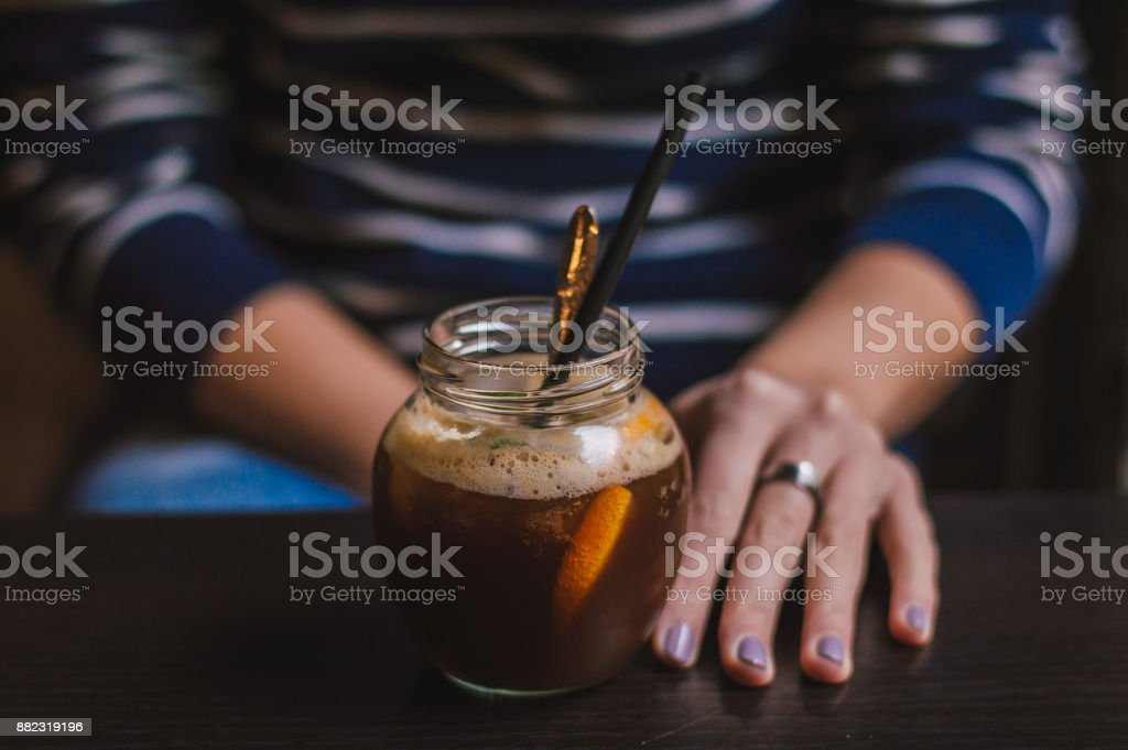 Close up of hands with coffee cup in a cafe stock photo