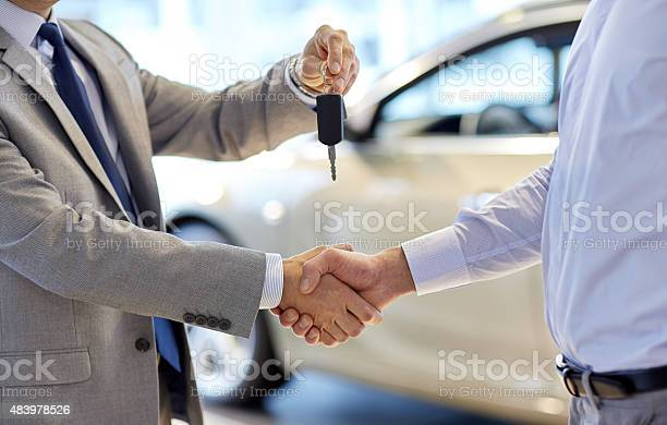 Close Up Of Handshake In Auto Show Or Salon Stock Photo - Download Image Now