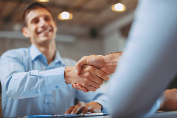 Close up of handshake in the office stock photo
