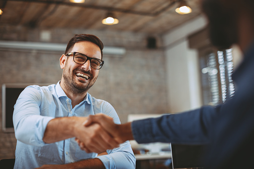 istock Close up of handshake in the office 935659716
