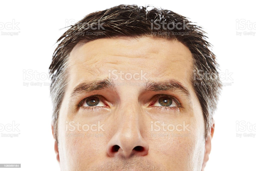 close up of handsome man looking above himself royalty-free stock photo