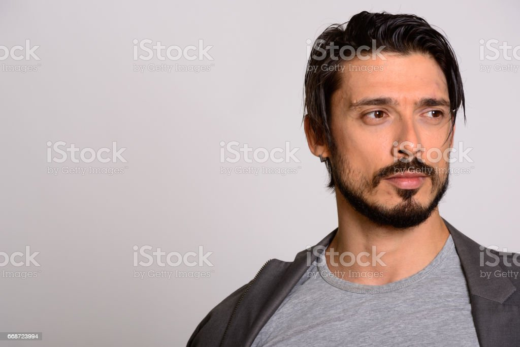 Close up of handsome man thinking while looking away stock photo