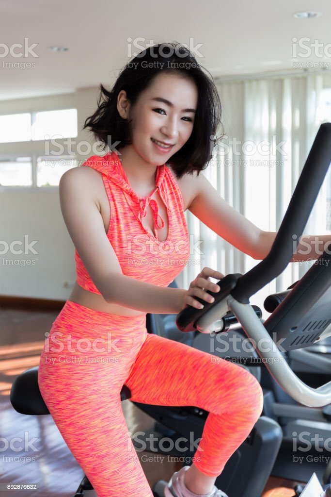 Close Up Of Happy Asian Woman Exercising In The Gym For Good Healthy Stock Photo